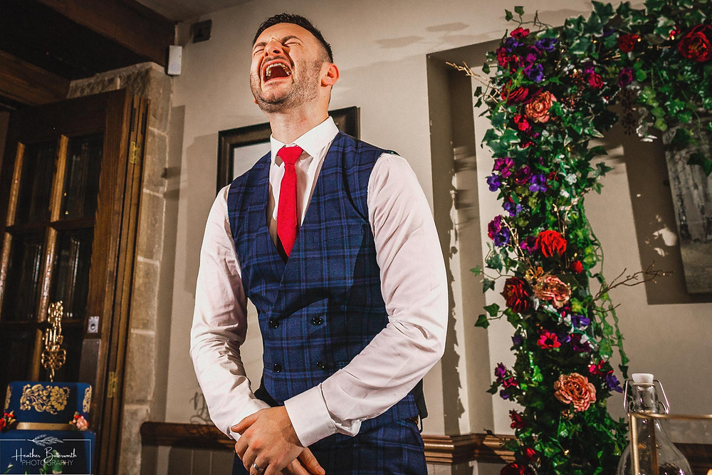 groom laughing at speech at the woodman inn Yorkshire