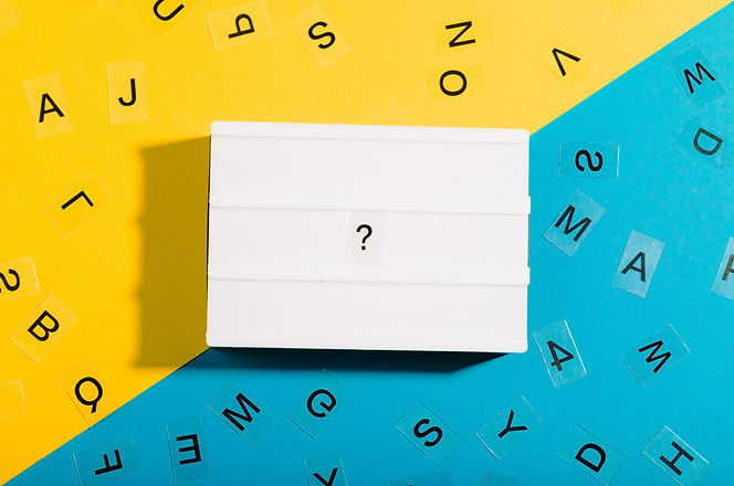 Light box with question mark on diagonal split bicolor yellow blue background, surrounded by letters