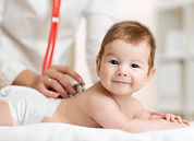 Happy-Infant-Baby-with-Pediatrician-Usin