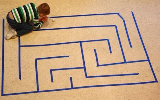 boy-playing-on-floor-with-adhesive-tape
