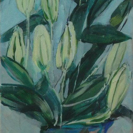 White lilies in a blue jug