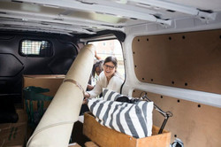 two-women-putting-furniture-into-van-768