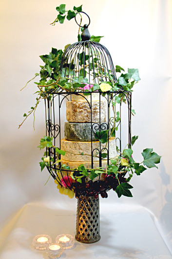 The Cheese Plate Wedding stack/cake in a cage