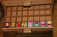 Bobbin stored in drawer partitions