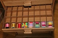 Bobbin partition fitted in drawer.