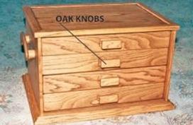 Craft storage box depicting 'oak knob' drawer opening