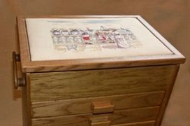 Cross stitch box with padded insert.