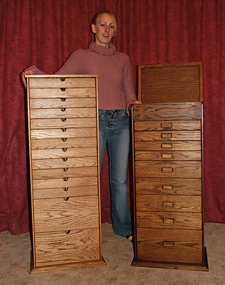 Daughter claire with two large sewing boxes.