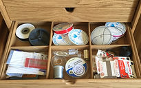 Craft odds & ends stored in bespoke partioned drawer.