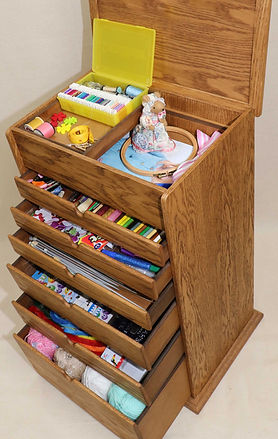 Embroidery box and sewng storage.