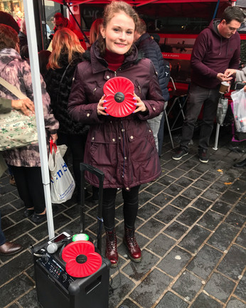 Singing for The Royal British Legion's Poppy Appeal in Liverpool.