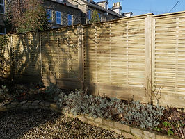 Woven panel fencing with double gravel b