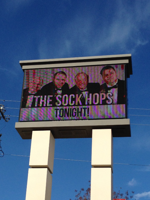 The Sock Hops sign