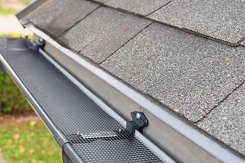 Plastic guard mesh over new dark grey pl