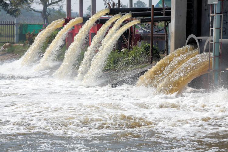 Wastewater discharging into storage pond.