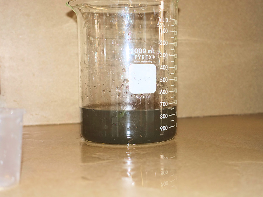 Filtrate from gravity drainage.