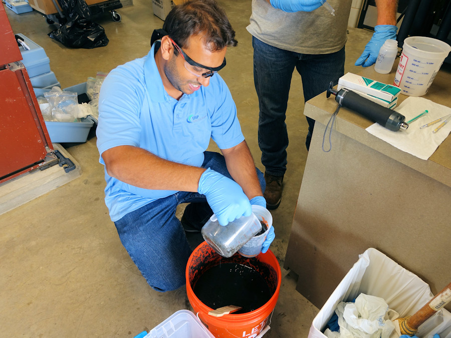 Collecting a sludge sample for conditioning.