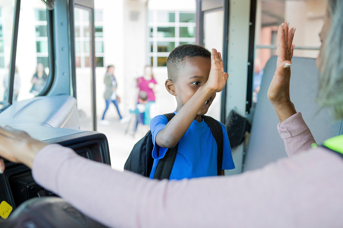 Child getting on School Bus