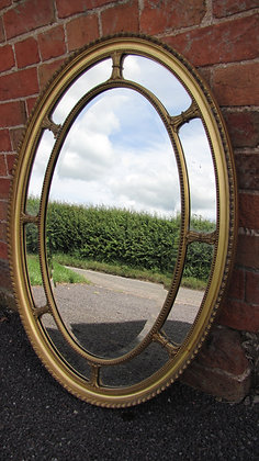 VICTORIAN GILTWOOD SECTIONAL OVAL MIRROR