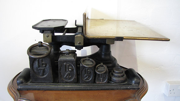Edwardian shop scales with square weights.