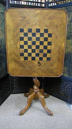 Walnut tilt top games chess table.