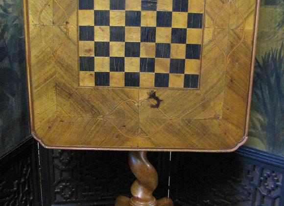 Walnut tilt top games chess table.