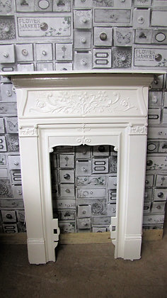 Small antique painted cast iron fire surround