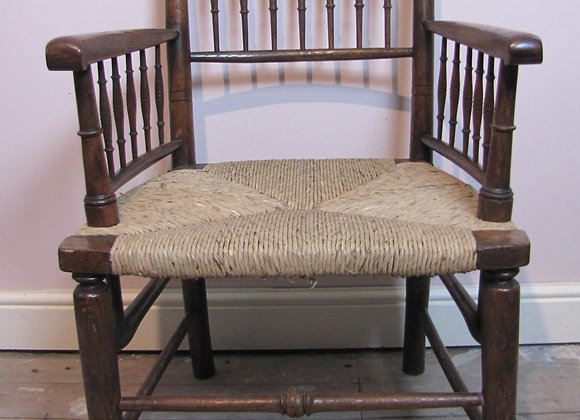 William Morris spindle back oak armchair