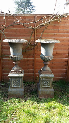 STUNNING PAIR OF CAST IRON URNS ON PLINTHS