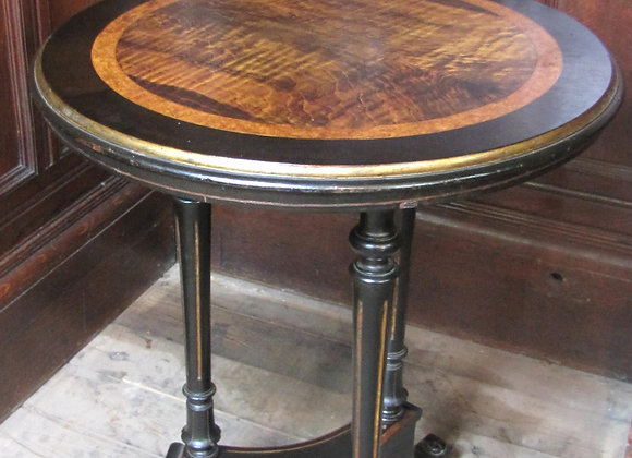 Antique ebonised circular wine occasion table