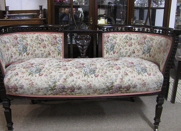 A Victorian upholstered settee by Cowtan & Sons, London