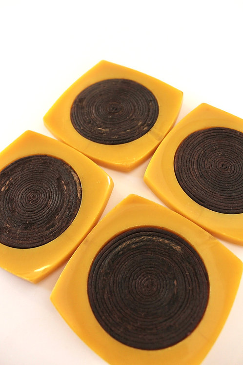 Set of 4 yellow plastic coasters