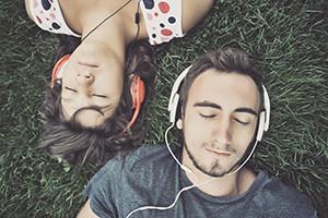 Couple listening to music on headphones