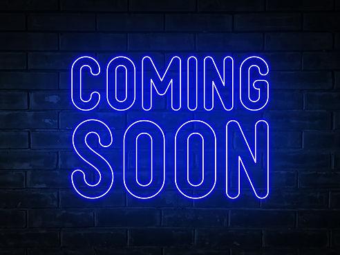 coming-soon-blue-neon-light-word-on-brick-wall-bac-JPMPCY6.jpg