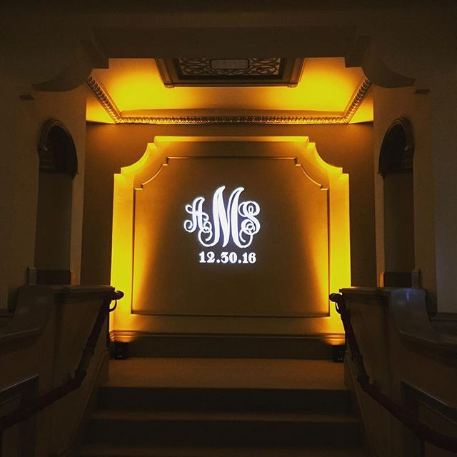Monogram in small area with uplighting