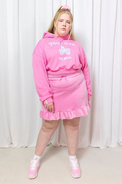 The pink frilly velour skirt