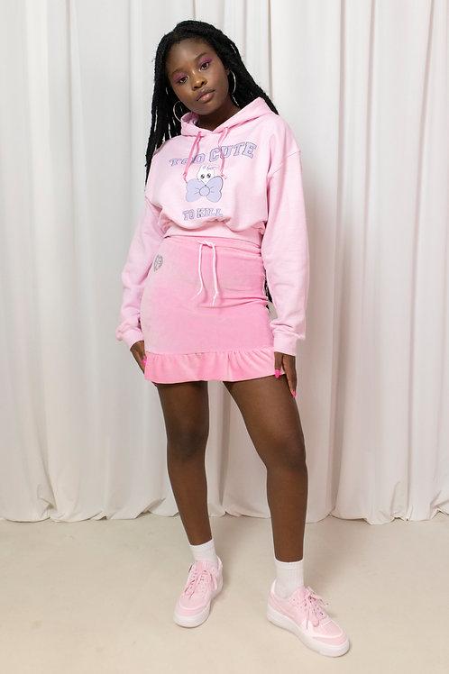 That light pink frilly velour skirt
