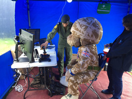 Fs Lloyd-Jones assisting the flight sim at Aberystwyth Show