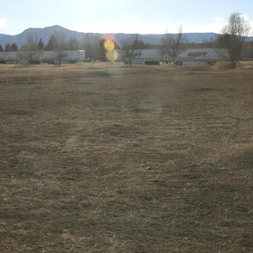View of the Mountains and Semi Trailers at Celestial Seasonings. January 2021 (left)