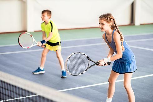 Happy children playing sport game on court.jpg