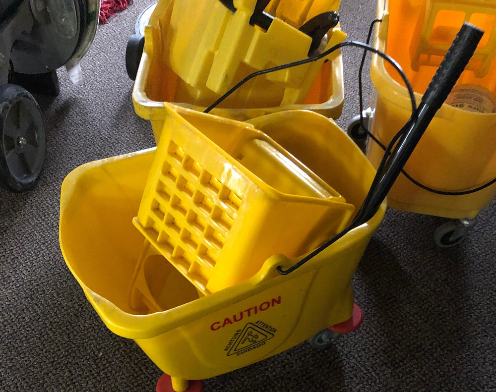 Mop and yellow water bin, Image from Next Level Building Solutions