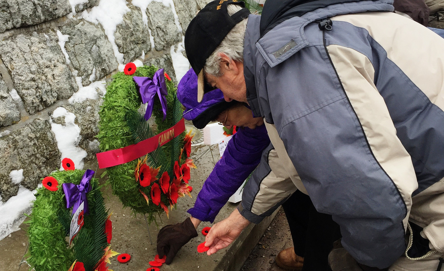 Laying Poppies at the Cenotaph