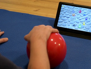 Ball exercise combined with gaming, this time working on hand-arm stability, strength and coordinatopn after multiple neurological and orthopedic disorders