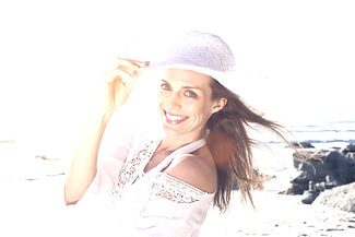 Close up portrait of a beautiful woman smiling with hat at the beach_edited.jpg