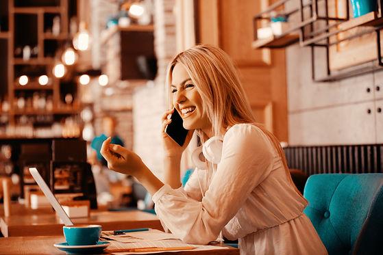 Modern business woman is drinking coffe