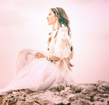 beautiful young stylish boho woman sitting on the beach at sunset_edited_edited.jpg