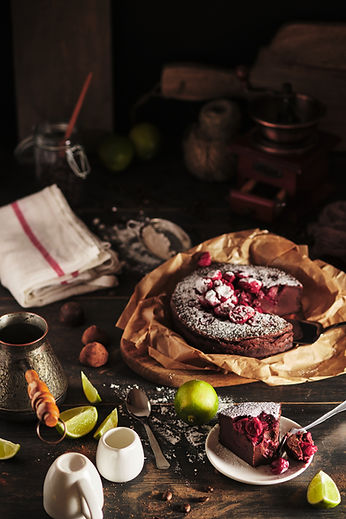 Slice of chocolate clafouti with cherry