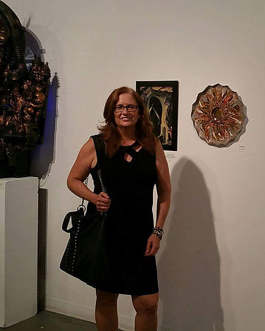 Carrie with her work at City Arts in Trenton