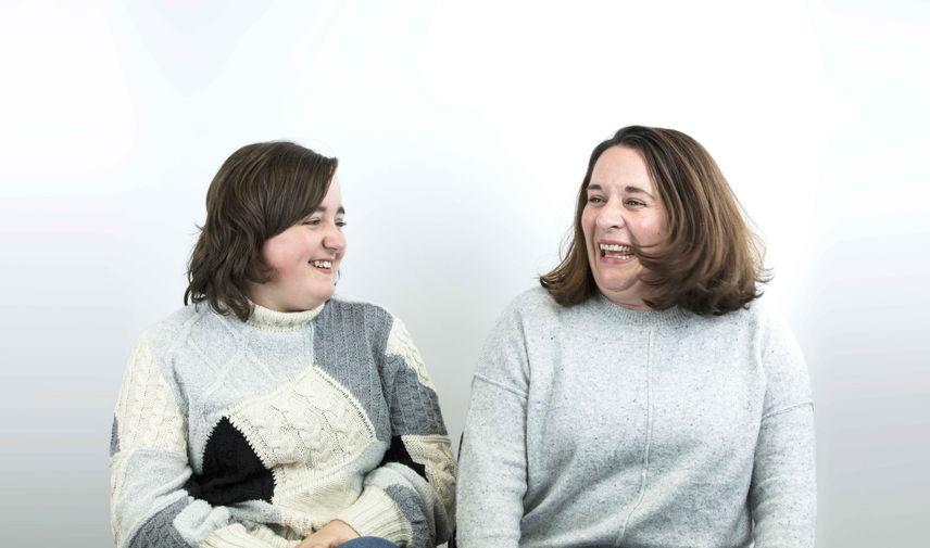 Emily-and-Katherine-smiling - 2 ladies sitting laughing