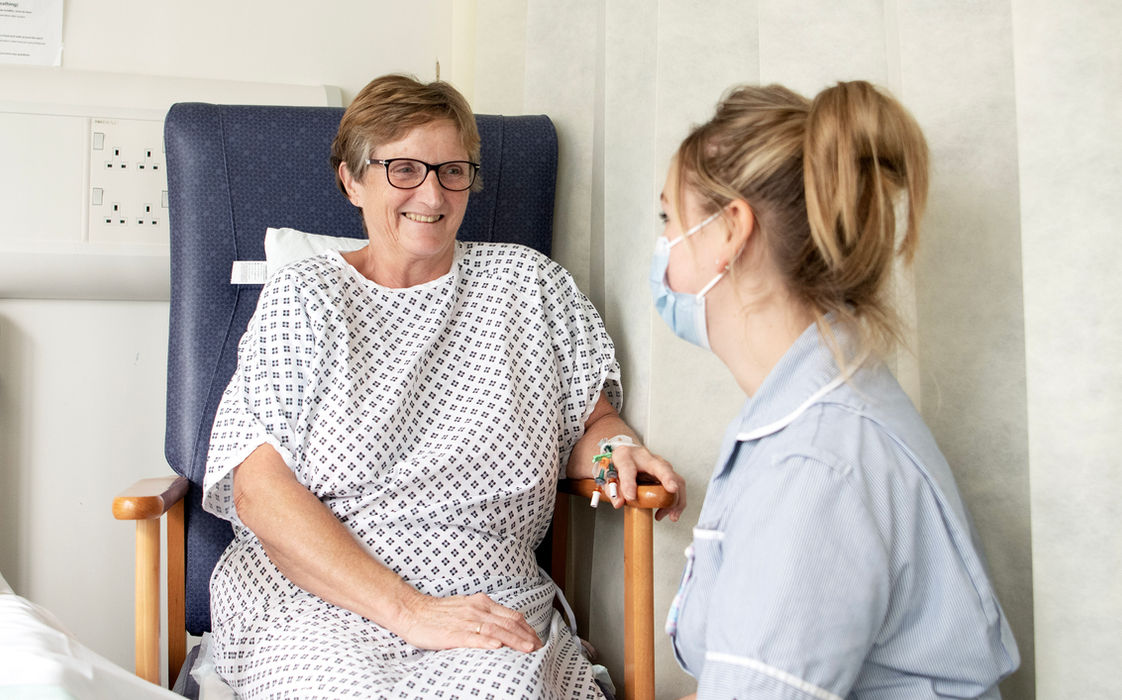 lady in hospital being cared for by nurse